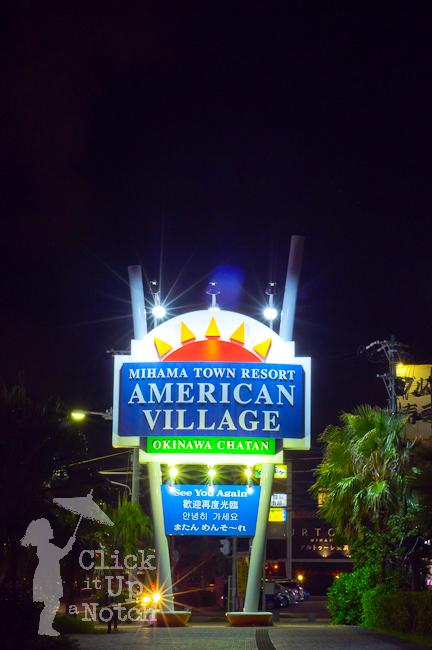 A lit up sign at night showing multiple starburst effects.