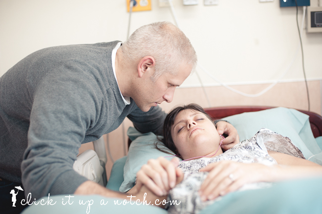 Mother and father spending time together during labor.
