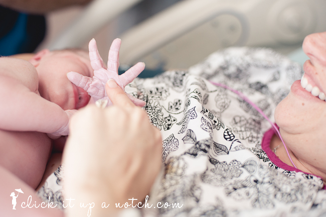 A tiny baby hand all stretched out captured by the birth photographer.