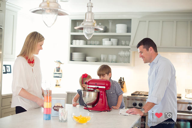 family backing with red kitchen aid during a lifestyle family photography session