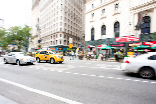 Beautiful image of taxi's and cars driving in a city using motion blur.
